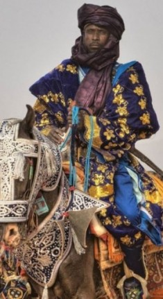 Hausa man and his horse in ceremonial dress [Source: Pinterest, Irene Becker]